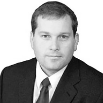 Image of Jon King, wearing a suit.